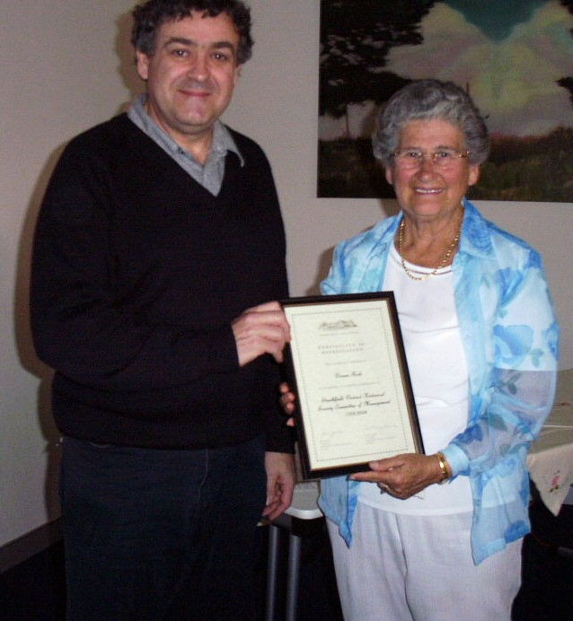 Mayor of Strathfield, Bill Carney and Doreen Rich in 2004, receiving certificate of service.