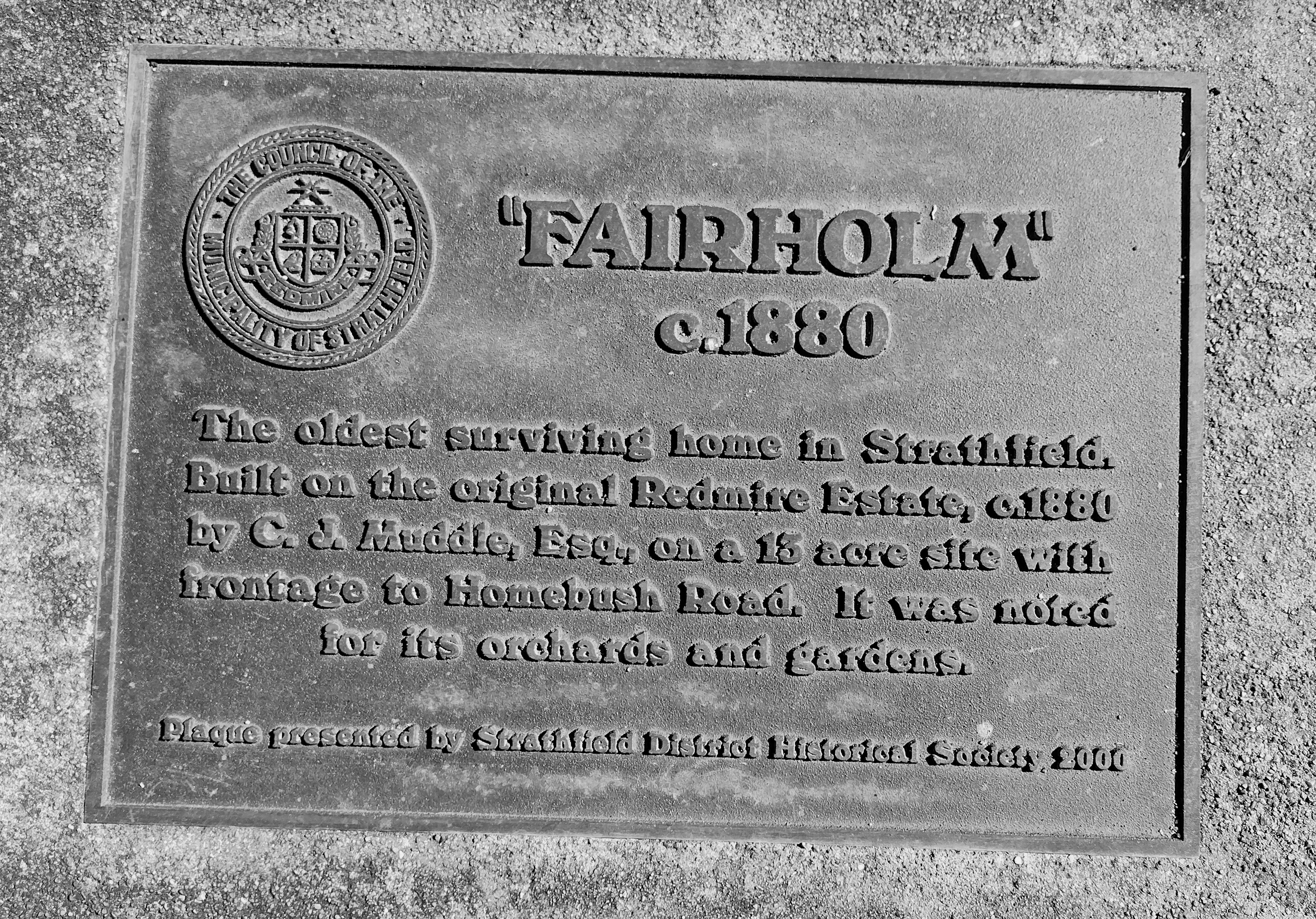 'Fairholm' brass plaque installed on naturestrip outside the former house 'Fairholm' c.1880. Erected 2000